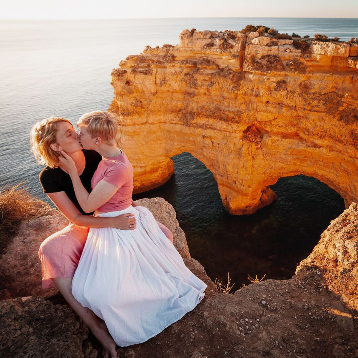 Couple of girls kissing in Lagos, Portugal