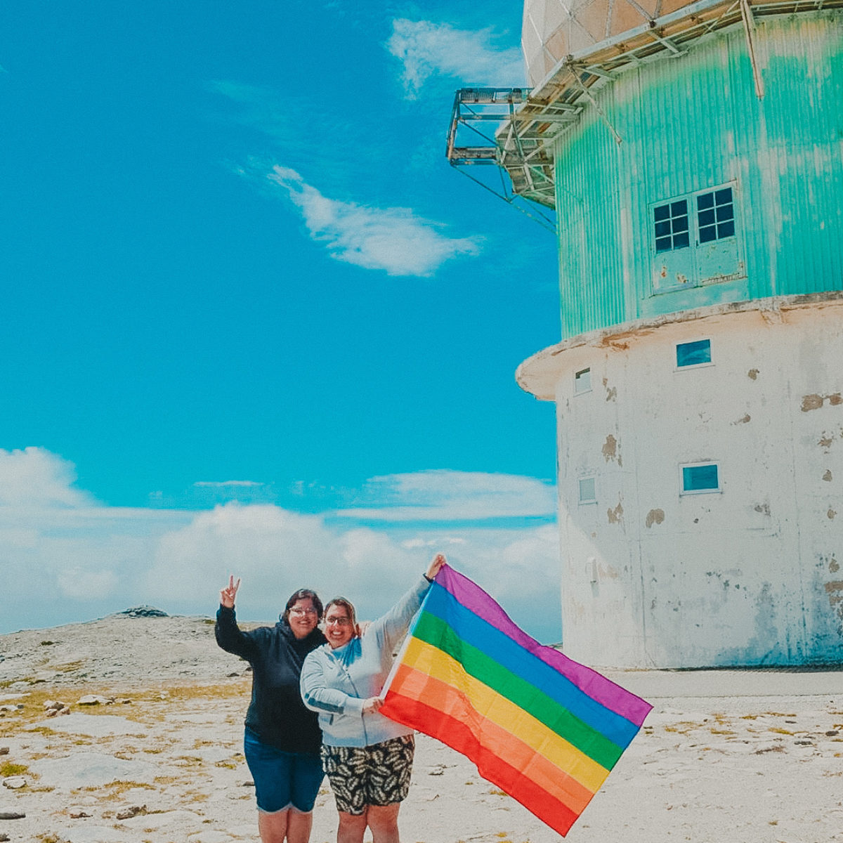 Lesbian couple holding rainbow flag in Portugal